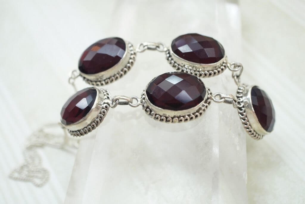 This Necklace with Garnet Set in Silver